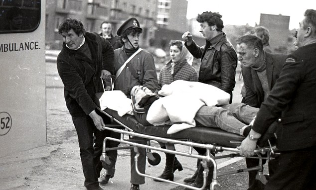 An injured protestor is stretchered away during the riots